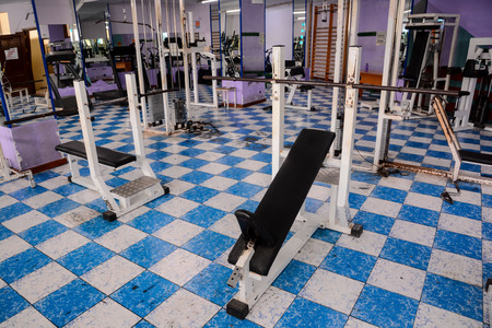 Equipment And Machines At The Empty Modern Gym Room Fitness Center Imagens