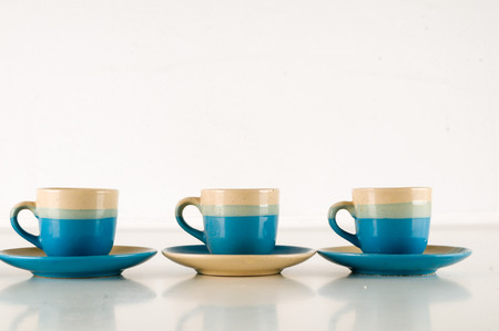 Small modern espresso cups on a white background