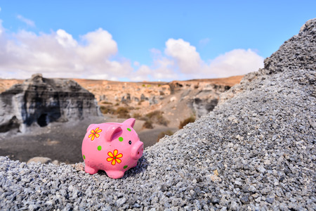 Conceptual Photo Picture of a Piggy Bank, Object in the Dry Desert