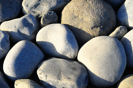 Texture of Round Rocks Smoothed by the Water