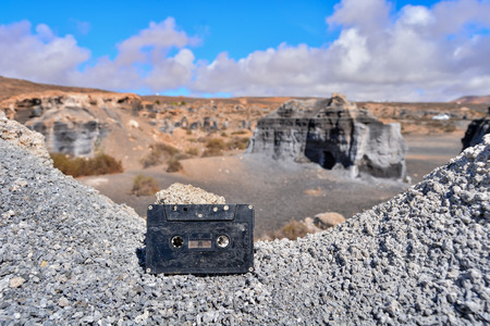 Conceptual Photo Picture of a Music Tape Cassette Object in the Dry Desert