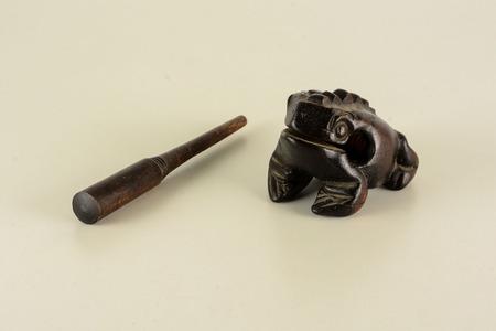 Typical vintage Oriental wooden frog musical instrument souvenir