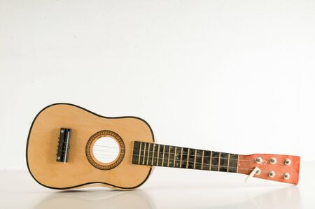 Close-up of Broken Guitar Object on a White Background Stock Photo