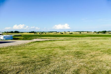 rural landscape with green field and blue sky, beautiful photo digital picture Stockfoto