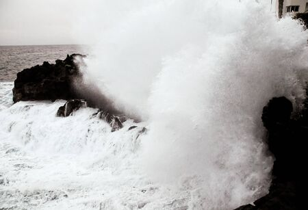 Strong Waves Crashing on the Volcanic Coast in Tenerife Canary Islands 写真素材