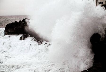 Strong Waves Crashing on the Volcanic Coast in Tenerife Canary Islands Фото со стока
