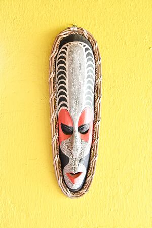 wooden mask on a white background, photo as a background, digital image