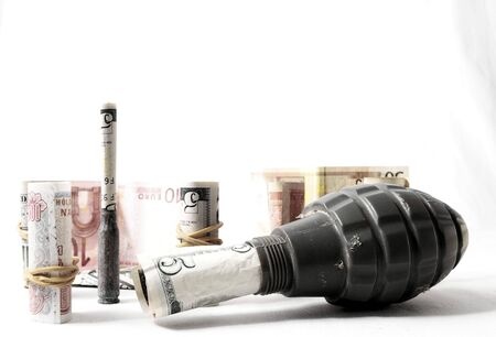 Money and Weapons Concept Weapons and Money on a White Background Imagens