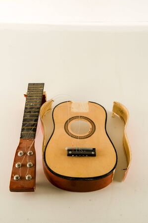 Close-up of Broken Guitar Object on a White Background