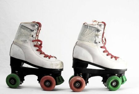 Used Vintage Consumed Roller Skate on a White Background