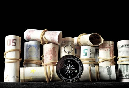 Orientation in Business Compass and Money on a Black Background