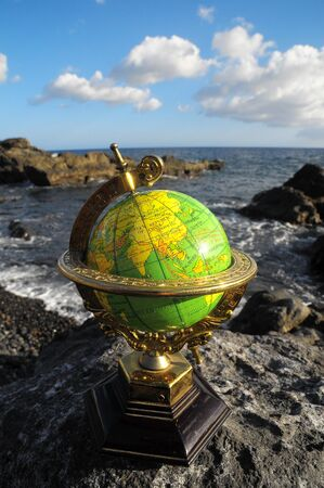 Ancient Vintage Globes Planet Earth near the Atlantic Ocean Фото со стока