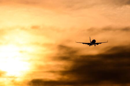 Photo picture Silhouette airplane flying on the sky Reklamní fotografie