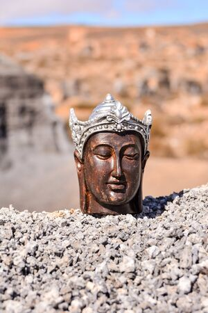 Conceptual Photo Picture of an Buddha in the dry desert 版權商用圖片