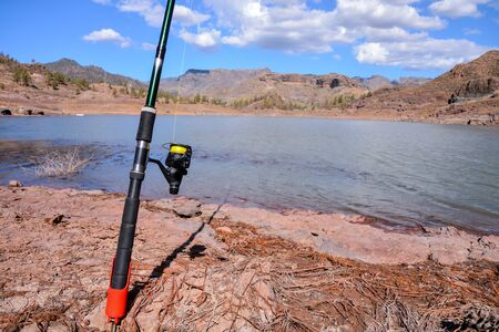 Conceptual Photo Picture Fishing with rod on a lake 版權商用圖片