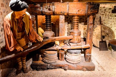 Ancient italian olive oil machine used to make oil