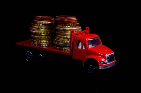 Transportation of Money for the Red Toy Truck Business Concept