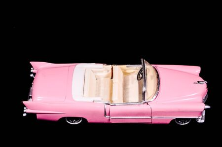 Pink Caddilac Car Toy Model Isolated on a Black Background
