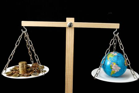 Globe Planet Earth and Money on a Two Pan Balance Stok Fotoğraf