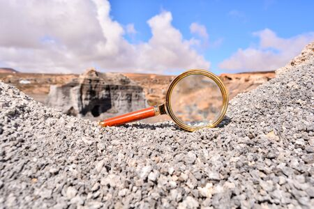 Conceptual Photo Picture of a Loupe Object in the Dry Desert