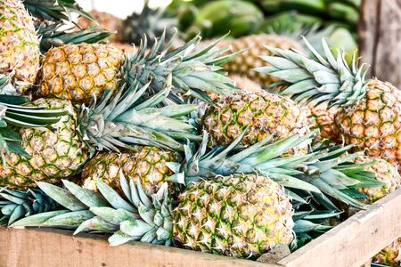 pineapples in the market, photo as a background, digital image