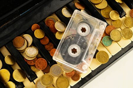 Photo picture close-up of piano keys keyboard and musicassette tape