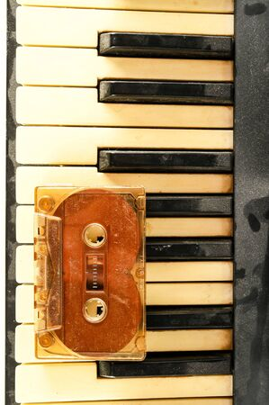 Photo picture close-up of piano keys keyboard and musicassette tape Stock Photo