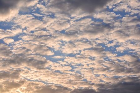 Cloudscape, Colored Clouds at Sunset near the Ocean Stockfoto