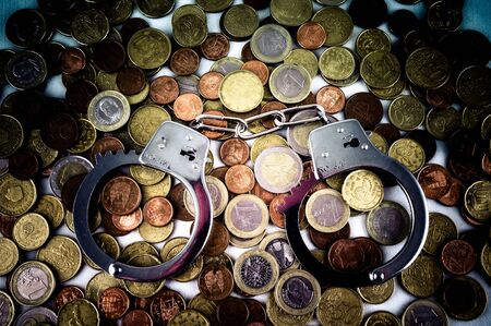Picture of a Business Money Concept Idea Conis and Handcuffs