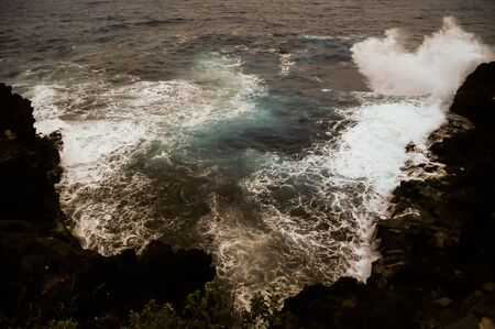 Strong Waves Crashing on the Volcanic Coast in Tenerife Canary Islands 스톡 콘텐츠