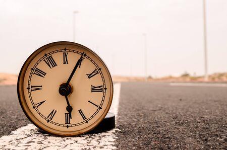 Time Concept Alarm Clock on the Asphalt Street