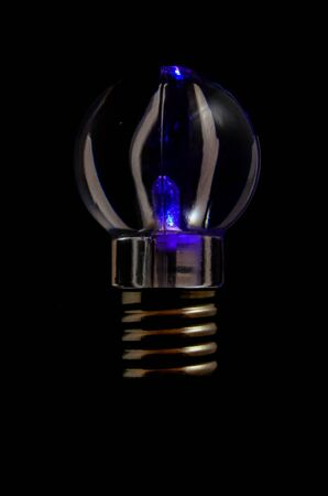 Photo of an Illuminated Light Bulb on Black Background