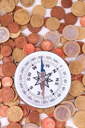 Picture of a Business Money Concept Idea Coins and Compass