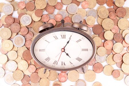 Picture of a Business Money Concept Idea, Clock and Coins Banco de Imagens