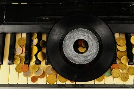 Photo picture close-up of piano keys keyboard and vinyl disk record Stock Photo