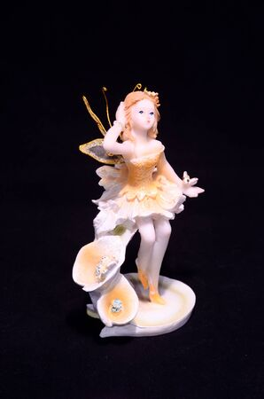 Clay Handmade Statue of a Fairy on Black Background