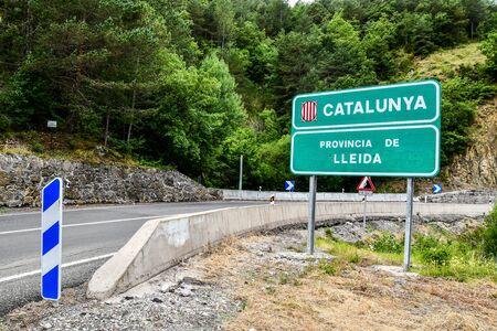 Spanish road border sign between Catalunya Lleida and Huesca Aragon in spain, background