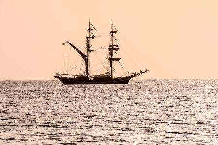 Photo Picture of a Sail Boat Silhouette at Sunset