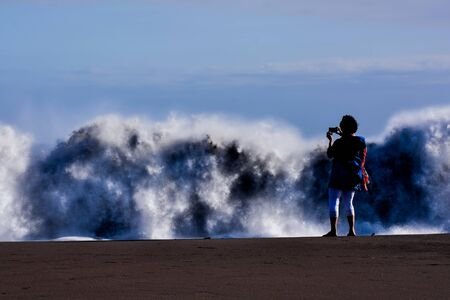 Rough Sea with Large Waves Breaking on the Coast Stock Photo