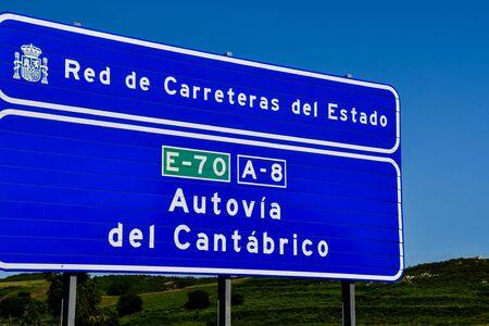 road sign, photo as a background, digital image Standard-Bild