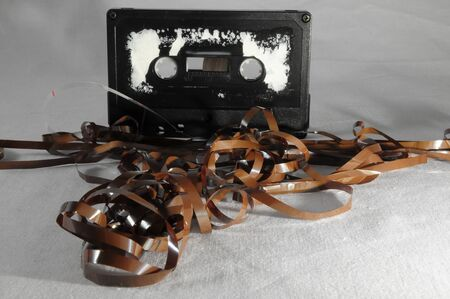 Ancient Vintage Used Musicassette over a White Background 版權商用圖片