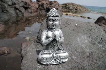 One Ancient Gray Buddha Statue Near The Ocean