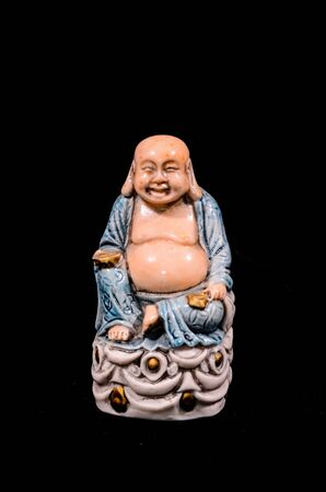 Oriental Buddist Statue Isolated on a Black Background Banco de Imagens