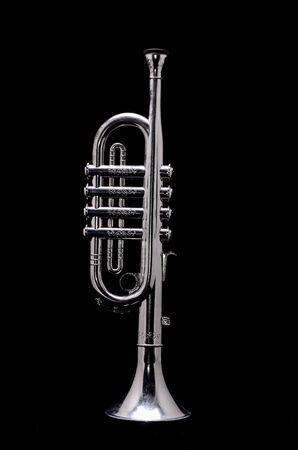 Silver Vintage Toy Trumpet on a Black Background Archivio Fotografico