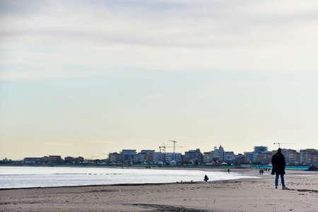 man on the beach, photo as a background, digital image Stock fotó