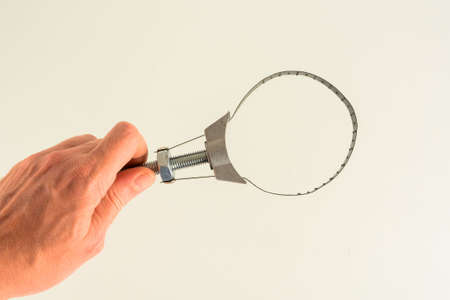 Photo of oil filter wrench on white background Stock Photo