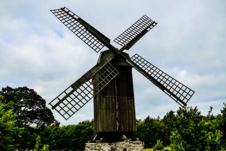 old wooden windmill on background of blue sky, in Sweden Scandinavia North Europe Stockfoto