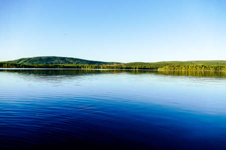landscape with lake and blue sky, in Sweden Scandinavia North Europe