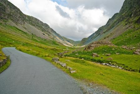 Leading road through Honniston Pass Stock Photo - 15195516