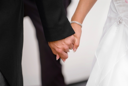 Just married couple holding hands on there journing together. photo